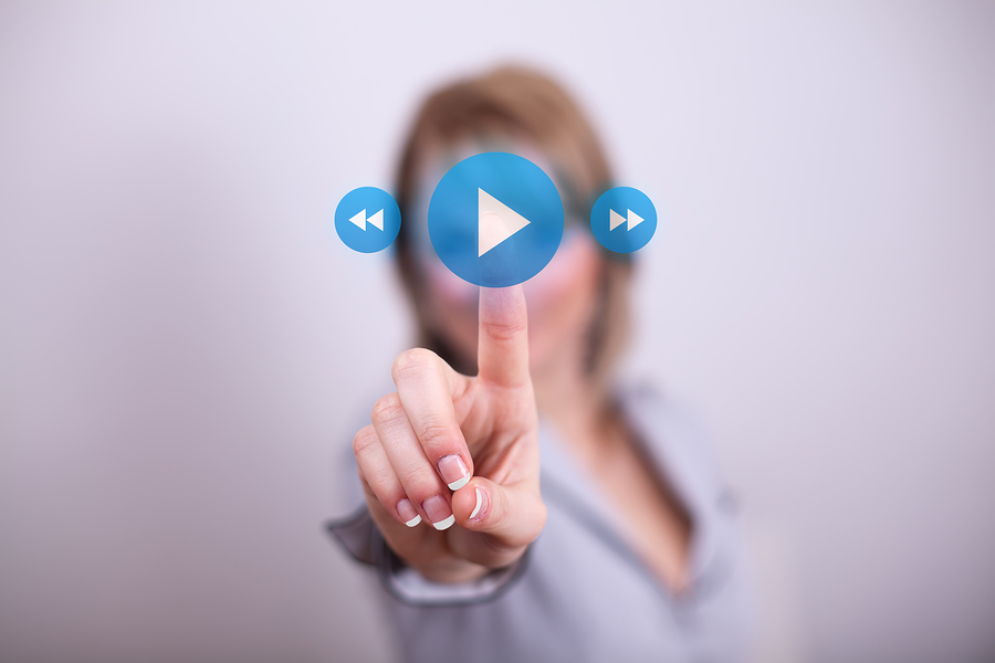 Woman pressing play button with one hand